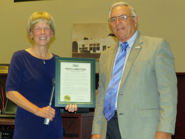 !karen-schuster-accepts-proclamation-from-richard-gilmour